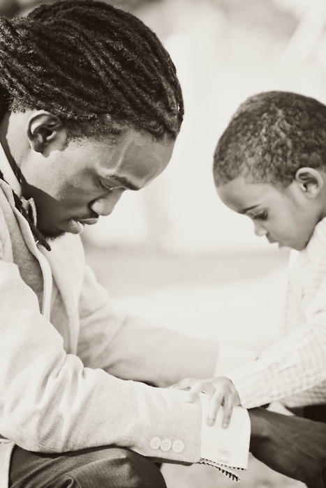 Father and child praying